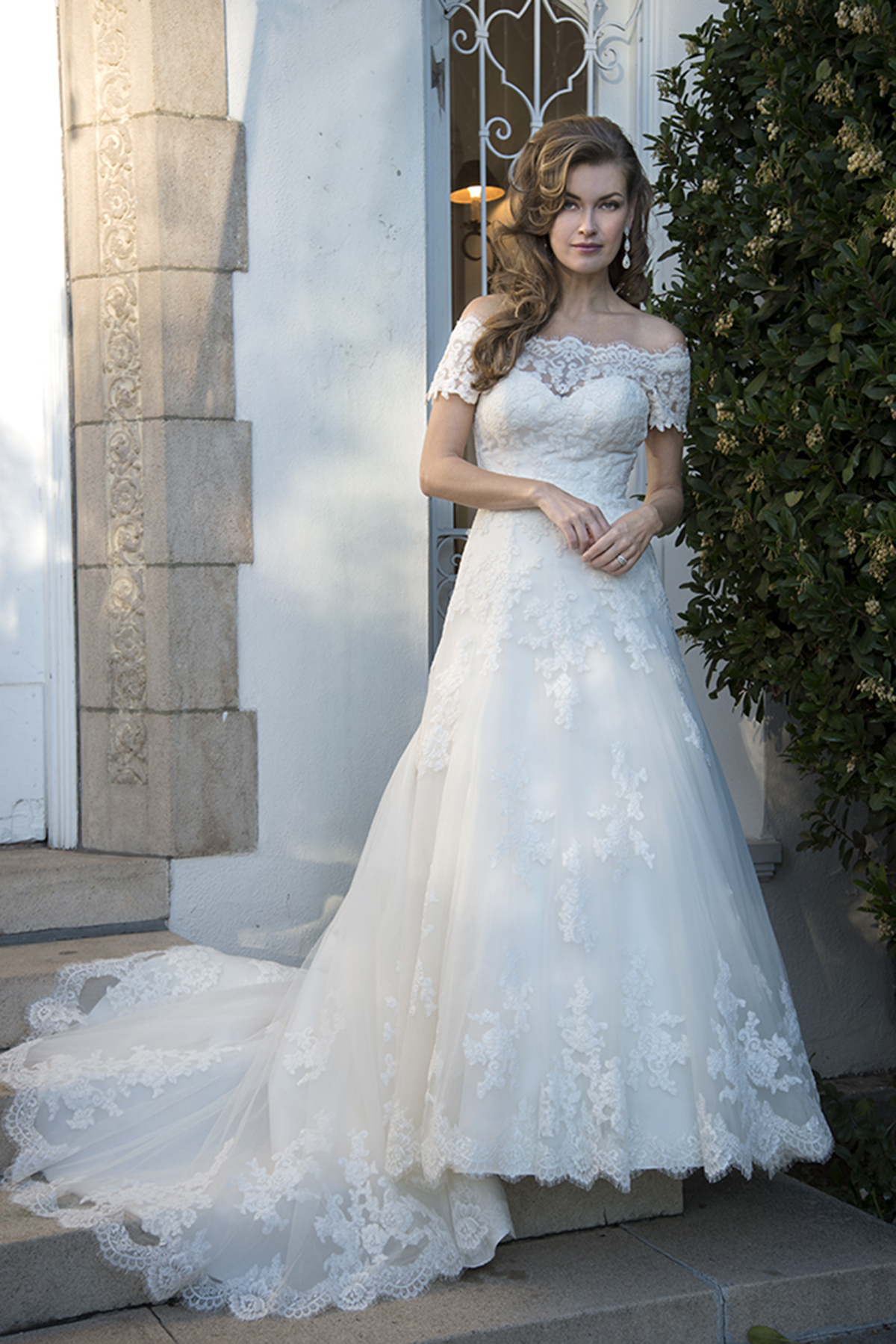 Vada (Venus VE8265) off shoulder lace A-line wedding dress.
